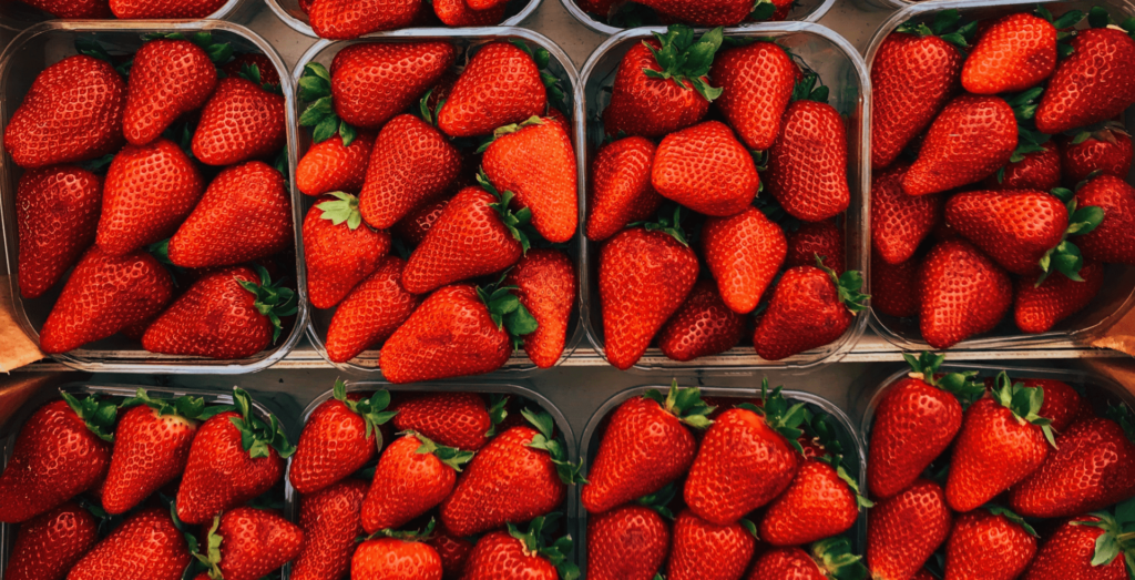 Close up of strawberries in containers